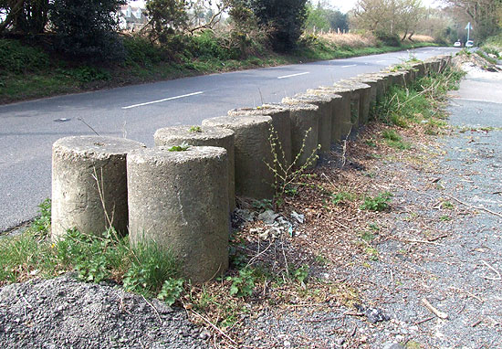 Line of roadblock cylinders